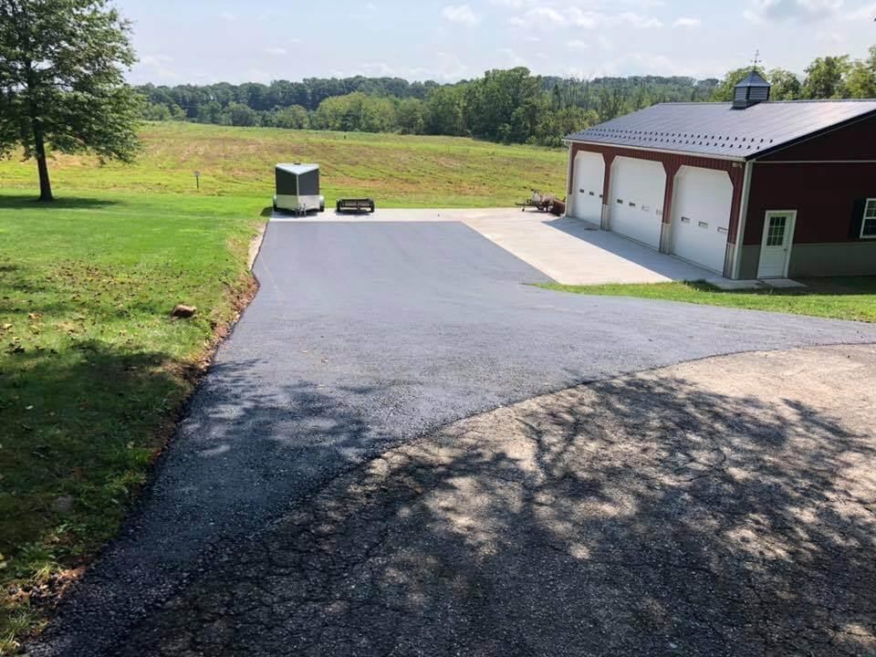 Tar and Chip vs Asphalt Paving tar and chip driveway